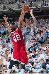 28 December 2006: North Carolina Tarheel forward (50) Tyler Hansbrough defended by Rutgers forward (42) Frank Russell during a 87-48 Rutgers Scarlet Knights loss to the North Carolina Tarheels, in the Dean Smith Center in Chapel Hill, NC.<br />