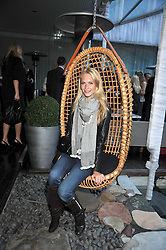 POPPY DELEVINGNE at the Total Concierge launch party held in the stylish Courtyard Garden at Sanderson, Berners Street, London on 26th May 2009.