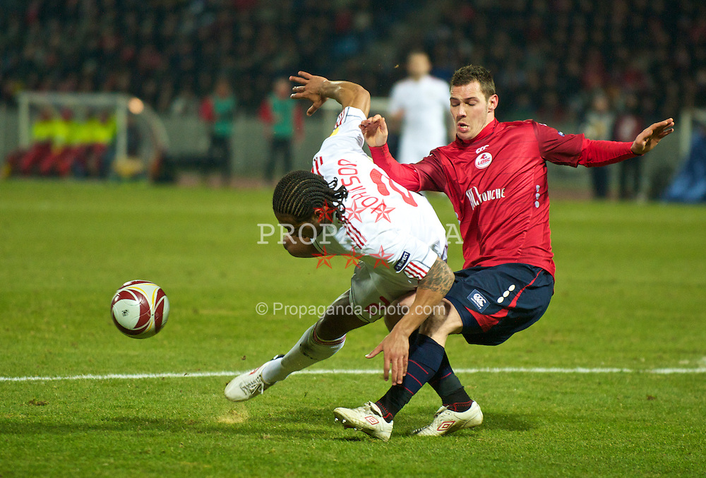 LILLE, FRANCE - Thursday, March 11, 2010: Liverpool's Glen Johnson in action against LOSC Lille Metropole during the UEFA Europa League Round of 16 1st Leg match at the Stadium Lille-Metropole. (Photo by David Rawcliffe/Propaganda)