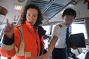 Nesrine performs a servere conrol of a plane.  At Roissy, Nesrine, 34, works as a technical inspector  for the DGCA (Directorate General of Civil Aviation) - she is the only female technical controller at the airport of Roissy-en-France. She can stop a Boeing taking off and make the 300 passengers leave the airplane. Nesrine Chkioua is the only woman controller at Roissy Airport and one of three women doing this job in France.<br /> <br /> <br /> &Agrave; Roissy, Nesrine, 34 ans, exerce le m&eacute;tier de contr&ocirc;leur technique (CTE) pour la DGAC (Direction g&eacute;n&eacute;rale de l&rsquo;aviation civile) - elle est la seule femme contr&ocirc;leur technique &agrave; l&rsquo;a&eacute;roport de Roissy-en-France.  Elle peut immobiliser un Boeing, retarder le d&eacute;collage et m&ecirc;me faire d&eacute;barquer les 300 passagers d&rsquo;un long-courrier. Nesrine Chkioua est la seule contr&ocirc;leur femme &agrave; Roissy a&eacute;roport et est une des trois femmes &agrave; exercer ce m&eacute;tier en France.
