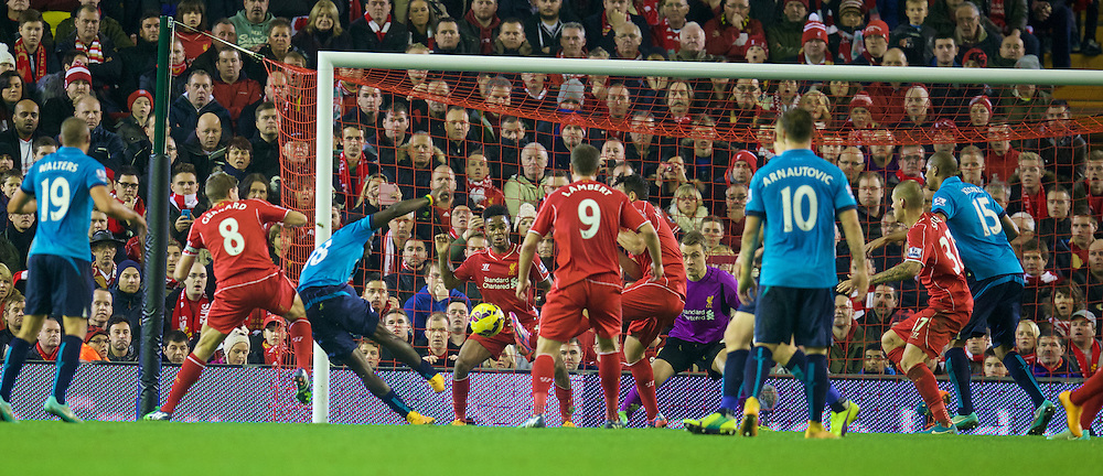 LIVERPOOL, ENGLAND - Saturday, November 29, 2014: Liverpool's Raheem Sterling blocks a shot on the line against Stoke City during the Premier League match at Anfield. (Pic by David Rawcliffe/Propaganda)