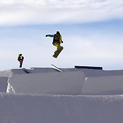 Snowboarders warming up before the Billabong Slope-Style 2011 at Snowpark, Wanaka, New Zealand. 5th August 2011