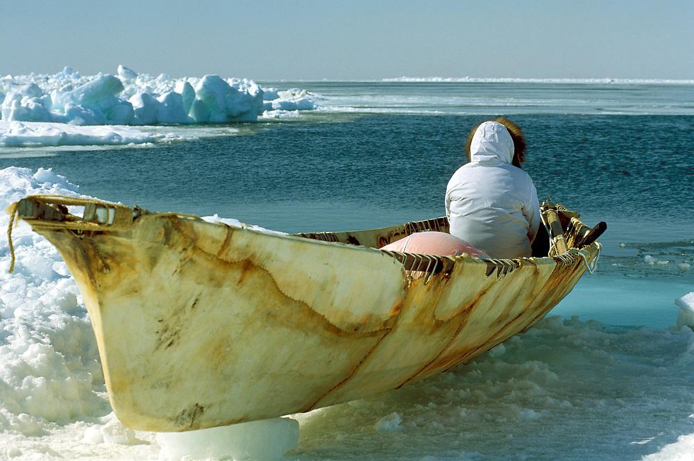 Global warming  and a traditonal boat in Barrow Alaska