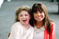 Repro Free: 29/06/2013<br /> Michaela Morley (8) from Mayo is pictured with Sandra O'Brien (22) from Gorey at a special event in Croke Park to mark 10 years of kidney transplantation at Temple Street Children&rsquo;s University Hospital. 80 of these children have received a transplant at Temple Street since 2003; 22 from a living donor (a parent or close relative) and 58 from a deceased donor (when the kidney is retrieved from someone who has died but who carried a donor card.) Over the ten years, the youngest recipient of a new kidney was two years of age and the oldest was 17 years. Picture Andres Poveda