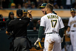 OAKLAND, CA - JULY 15:  Bob Melvin #6 of the Oakland Athletics and Yonder Alonso #17 are ejected after arguing a called third strike by umpire Mark Wegner #14 during the fourth inning against the Toronto Blue Jays at the Oakland Coliseum on July 15, 2016 in Oakland, California. (Photo by Jason O. Watson/Getty Images) *** Local Caption *** Bob Melvin; Yonder Alonso; Mark Wegner