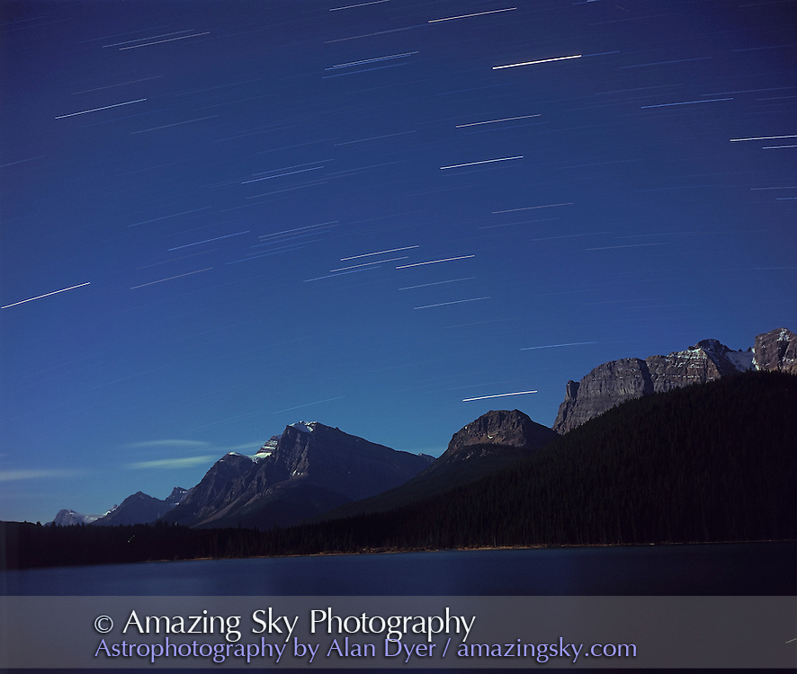 Star trails over Bow Lake, Banff National park, Alberta. Looking south.<br /> <br /> Taken in full moonlight with Plaubel Makina 6x7 camera with 80mm lena at f/5.6 and Fujichrome Velvia 50 slide film, 120-format, and about 20 minute exposure. taken from near Num-Ti-jah Lodge.