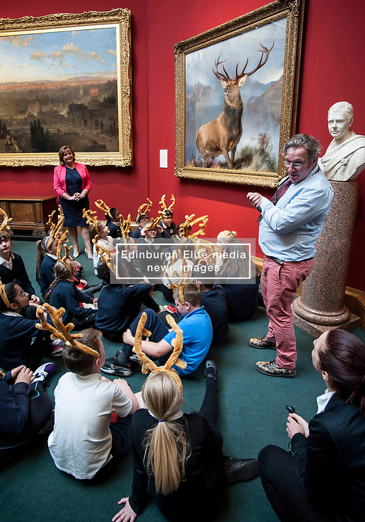 Culture Secretary Fiona Hyslop watches as National Galleries Educator Darren Robertson tells pupils from St Ninians primary school - all wearing antlers to mark the occasion - about the  launch the nationwide tour of the famous 'Monarch of the Glen' painting by Sir Edwin Landseer.<br /> <br /> © Dave Johnston/ EEm