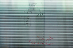 © Licensed to London News Pictures. 21/03/2018. London, UK. The words 'DATA', 'DIGITAL' and 'REGULATIONS?' written in the window of the London offices of Cambridge Analytica. Cambridge Analytica has been implicated in an investigation into the misuse of Facebook user data to influence the outcome of elections. Photo credit: Rob Pinney/LNP