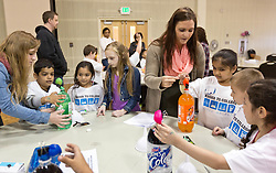 PLU Education students work with kindergarden students from Kent on science projects at PLU on Thursday, April 23, 2015. (Photo: John Froschauer/PLU)