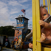 A doll found during a Mississippi River cleanup effort clings to the barge where Chad Pregracke works and lives.   In 1998 Pregracke  founded Living Lands & Waters, the not-for-profit environmental organization based in East Moline, Illinois. Today, there are several employees and a fleet of several barges and workboats. Thousands of volunteers have cooperated to help with the community cleanups.  Tons of waste are cleaned out of rivers each year thanks to Pregracke's efforts.
