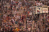 Helio Castroneves climbs the fence after his win at the Richmond International Raceway, SunTrust Indy Challenge, June 25, 2005
