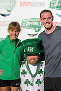 Monika Korra (L) and Boo Bryant (R), winners of the mens and women's races, pose for a photo with Jason Owens (center) at the Dallas St. Patrick's Parade on Greenville Avenue, Saturday, March 16, 2013. (Cooper Neill/The Dallas Morning News)