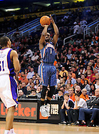 Feb. 4, 2012; Phoenix, AZ, USA; Charlotte Bobcats guard Kemba Walker (1) puts up a shot against the Phoenix Suns during the first half at the US Airways Center.  The Suns defeated the Bobcats 95 - 89. Mandatory Credit: Jennifer Stewart-US PRESSWIRE.