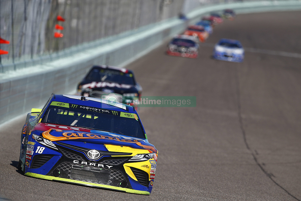 November 19, 2017 - Homestead, Florida, United States of America - November 19, 2017 - Homestead, Florida, USA: Kyle Busch (18) battles for position during the Ford EcoBoost 400 at Homestead-Miami Speedway in Homestead, Florida. (Credit Image: © Justin R. Noe Asp Inc/ASP via ZUMA Wire)
