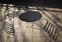 """Shadows of a table and chairs in one of the courtyards of the J. Paul Getty Museum, located in Los Angeles. The collection of the J. Paul Getty Museum on display at the Getty Center includes """"pre-20th-century European paintings, drawings, illuminated manuscripts, sculpture, and decorative arts; and 19th- and 20th-century American and European photographs"""". The museum is one of the most visited museums in the United States with an estimated 1.8 million visitors annually."""