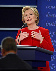 Former United States Secretary of State Hillary Clinton, the Democratic Party nominee for President of the US makes a point as she appears in the first of three presidential general election debates with businessman Donald J. Trump, the Republican Party nominee for President of the US at Hofstra University in Hempstead, New York, USA, on Monday, September 26, 2016. Photo by Ron Sachs/CNP/ABACAPRESS.COM