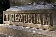 The inscription 'In Memoriam' is written at the base of a statue artwork located in the Victorian cemetery at Nunhead in south London, on 1st march 2020, in London, England. Nunhead is of the great Victorian Cemeteries of London. Consecrated in 1840, it is one of the seven great Victorian cemeteries established in a ring around the outskirts of London, its 52-acre site near Peckham is the final resting place for many members of Victorian society: From music hall artists, inventors, WW1, and soldiers who survived the battles of Waterloo and Trafalgar.