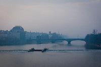 View of the Vltava River in Prague early morning with mist and fog. Prague is one the most popular destinations in Europe.