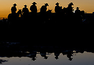 Cowboys mingle while riding their horses in a ring outside Adams Equestrian Arena before the Professional Rodeo Cowboys Association Rodeo on opening night Friday, Feb. 26, 2016, at the St. Lucie County Fair in St. Lucie County.