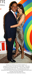 Model LIZ HURLEY and ARUN NAYAR, at a party in London on 20th October 2003.PNP 235