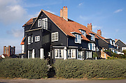 Black shingled wooden homes in Thorpeness, Suffolk, England