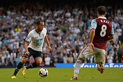 Tottenham Hotspur's Andros Townsend runs with the ball at West Ham United's Razvan Rat - Photo mandatory by-line: Mitchell Gunn/JMP - Tel: Mobile: 07966 386802 06/10/2013 - SPORT - FOOTBALL - White Hart Lane - London - Tottenham Hotspur V West Ham United - Barclays Premiership