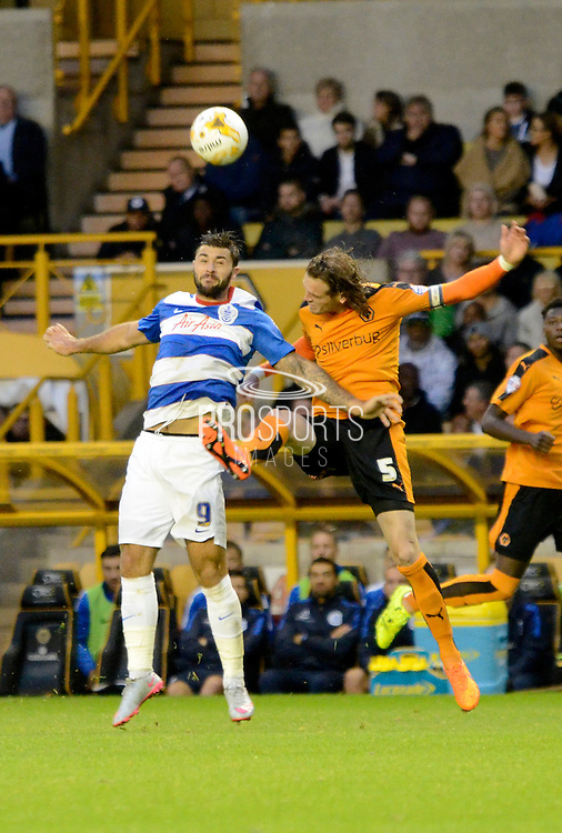 Richard Stearman and Charlie Austin battle for a header during the Sky Bet Championship match between Wolverhampton Wanderers and Queens Park Rangers at Molineux, Wolverhampton, England on 19 August 2015. Photo by Alan Franklin.