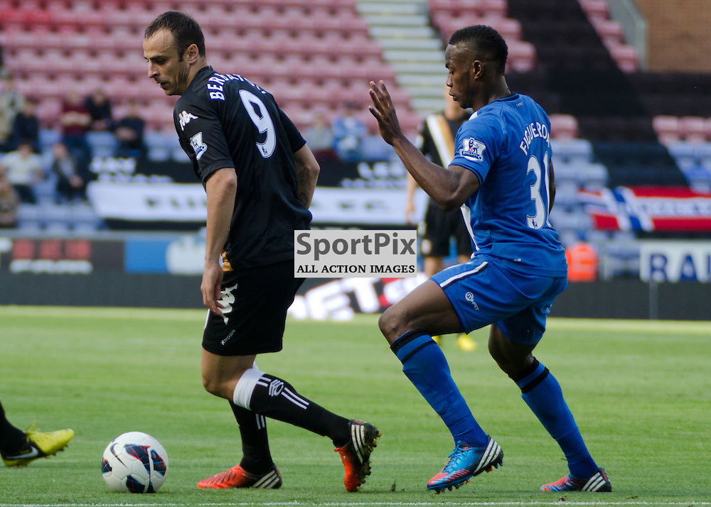 Fulham's Dimitar Berbatov controls the ball infront of Wigan's Maynor Fiueroa - Wigan Athletic v Fulham Barclays Premier League DW Stadium 22 September 2012 (c) Greig Bertram | StockPix.eu