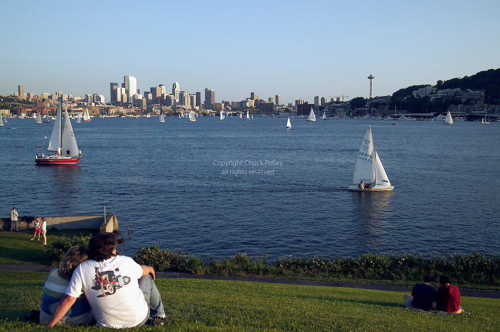 People at Gasworks Park watching Duck Dodge sailboat racing on Lake Union, Seattle, Washington<br />