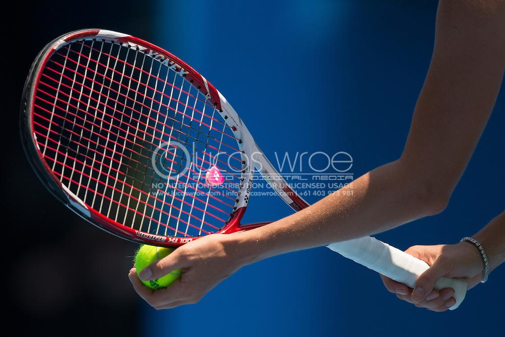 Caroline Wozniacki (DEN) Racket And Ball Gather In Preparation To Serve. Day 8. Round 4. Melbourne Olympic Park, Melbourne, Victoria, Australia. 21/01/2013. Photo By Lucas Wroe