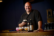Tim Kovac, founder and brewmaster at Small Town Brewery stands with some beers in the new tap room Friday, August  7, 2015, in Wauconda, ILL. Kovac brews an alcoholic root beer called Not Your Father&rsquo;s Root Beer which is 5.9% alcohol by volume, and also makes other unique beers. <br /> CREDIT: Rob Hart for The Wall Street Journal<br /> SLUG: ROOTBEER
