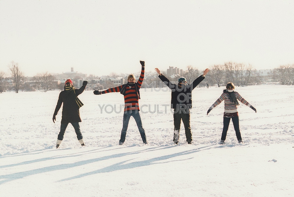 Teenagers in a snowy London park recreating cover of the Beatles Help album. London, Greenford, UK, 1981.