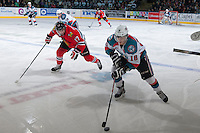 KELOWNA, CANADA - APRIL 25: Adam Rossignol #17 of the Portland Winterhawks checks Kris Schmidli #16 of the Kelowna Rockets as he skates with the puck on April 25, 2014 during Game 5 of the third round of WHL Playoffs at Prospera Place in Kelowna, British Columbia, Canada. The Portland Winterhawks won 7 - 3 and took the Western Conference Championship for the fourth year in a row earning them a place in the WHL final.  (Photo by Marissa Baecker/Getty Images)  *** Local Caption *** Adam Rossignol; Kris Schmidli;