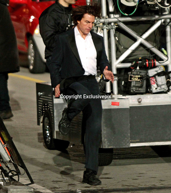 Jan. 07, 2011 - Vancouver, BC, CANADA - <br /> Tom Cruise Warms up while On The Set Of  'Mission Impossible 4'<br /> <br /> Actor Tom Cruise stretches and warms up before filming on the set of Mission Impossible 4, which is also known as Ghost Protocol in Vancouver, B.C., late Friday January 7, 2011. The Vancouver Convention Centre and the streets around it were transformed into a city in India for the scenes. <br /> ©Darryl Dyck/Exclusivepix)<br /> <br /> Exclusivepix<br /> 23 Kirby Rd<br /> Essex<br /> SS14 1Rx<br /> 07957 300 702