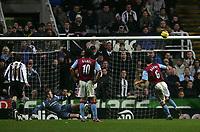 Photo: Andrew Unwin.<br />Newcastle Utd v Aston Villa. The Barclays Premiership.<br />03/12/2005.<br />Aston Villa's Gareth Barry (#6) fires his penalty over the bar.