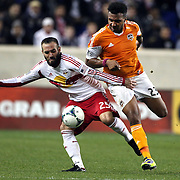 Brandon Barklage, New York Red Bulls, is challenged by Giles Barnes, Houston Dynamo, during the New York Red Bulls V Houston Dynamo , Major League Soccer second leg of the Eastern Conference Semifinals match at Red Bull Arena, Harrison, New Jersey. USA. 6th November 2013. Photo Tim Clayton