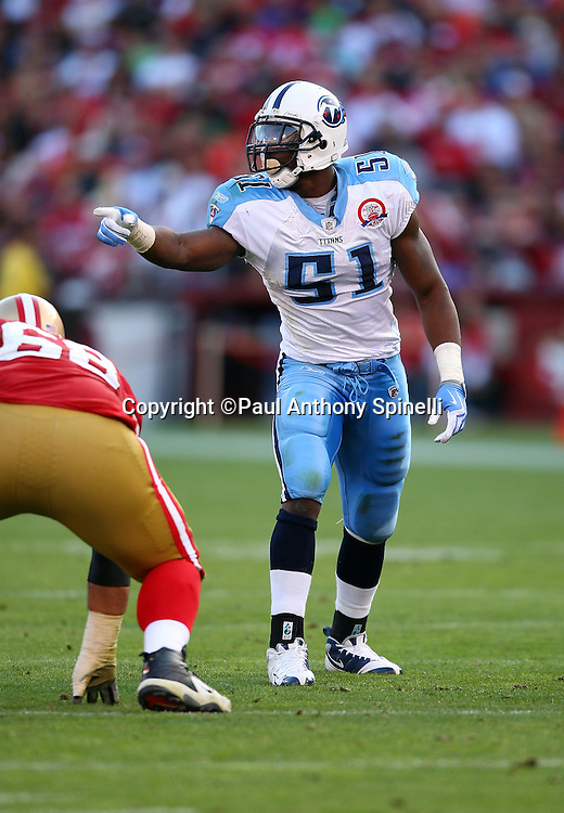 Tennessee Titans linebacker Gerald McRath (51) points toward the offensive alignment during the NFL football game against the San Francisco 49ers, November 8, 2009 in San Francisco, California. The Titans won the game 34-27. (©Paul Anthony Spinelli)