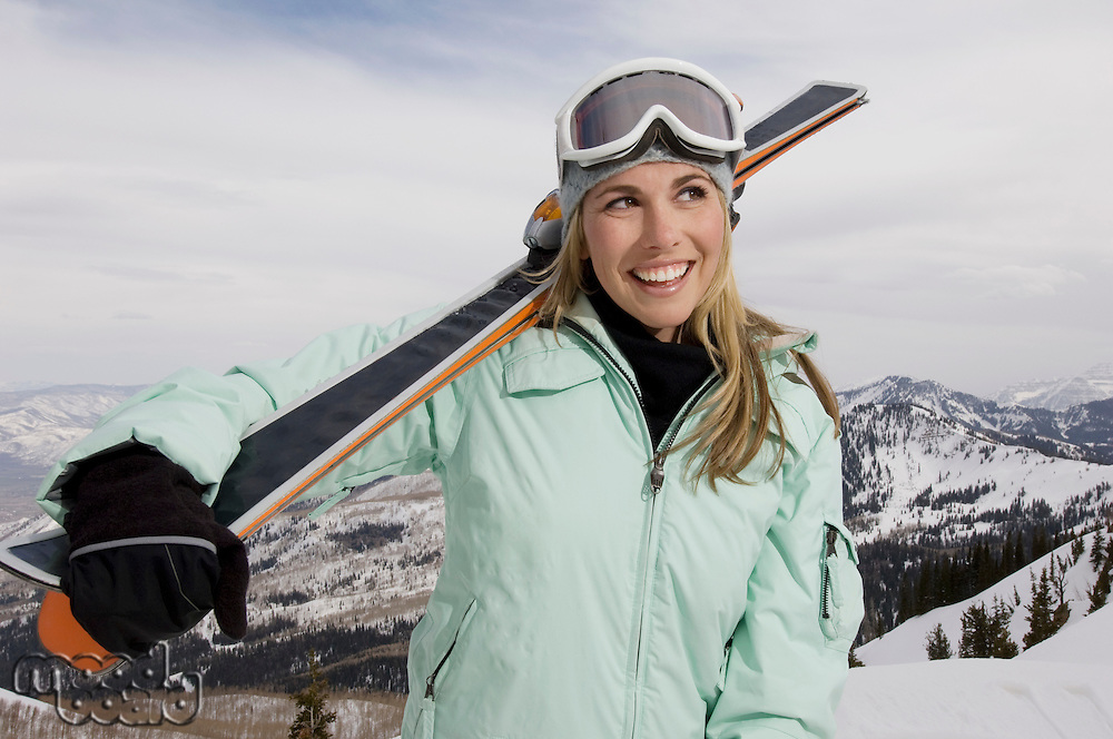 Skier Carrying Skis on Mountain