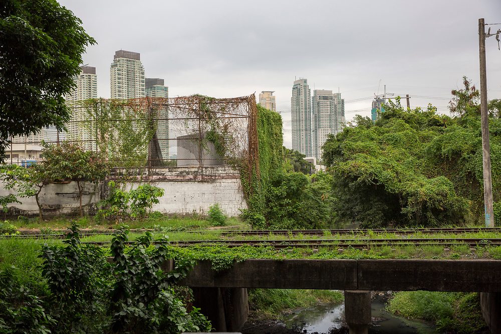 Overgrown train track which is part of the railway line through Manila, Metro Manila, Philippines. The iconic Manila skyline can be seen in the background.  (photo by Andrew Aitchison / In pictures via Getty Images)