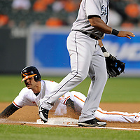 09 June 2009:  Baltimore Orioles second baseman Brian Roberts (1) steals third base in the 1st inning in action against the Seattle Mariners at Camden Yards in Baltimore, MD.  The Orioles defeated the Mariners 3-1.  ****For Editorial Use Only****
