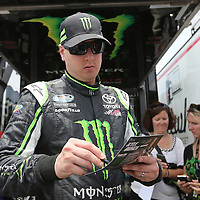 Driver Kyle Busch signs autographs during the Nationwide practice session at Daytona International Speedway on Thursday, July 3, 2014 in Daytona Beach, Florida.  (AP Photo/Alex Menendez)