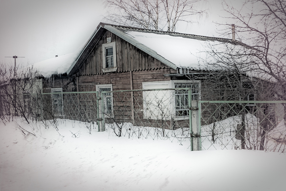 House snowed in a rural area of Russia