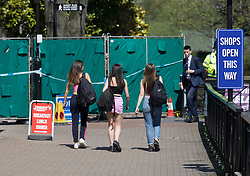 © Licensed to London News Pictures. 20/04/2018. Salisbury, UK. Shoppers pass a new barrier erected near the area of The Maltings where the Skripals were found - as a cleanup operation begins in Salisbury. Former Russian Spy Sergei Skripal and his daughter Yulia were poisoned using a nerve agent in the city last month. Experts have warned that 'Toxic levels' of the nerve agent novichok could still be present at hot spots around the city. Photo credit: Peter Macdiarmid/LNP