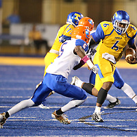 Tupelo quarterback Stephon McGlaun helped lead the Golden Wave to a 38-0 lead over Southaven in the first half Friday night.