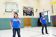 Siblings Teresa Salgado-Ellis and Jeremy Salgado make a statement about their father, Harry Salgado, during the Harry Salgado scoreboard dedication ceremony at Sierramont Middle School in San Jose, California, on January 8, 2015. (Stan Olszewski/SOSKIphoto)