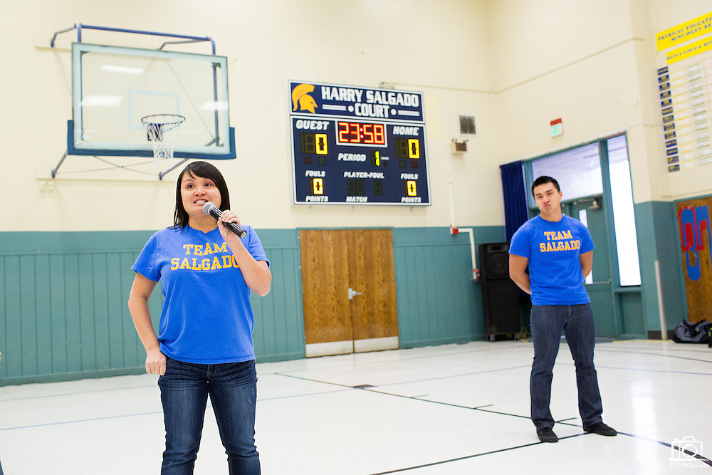 Siblings Teresa Salgado-Ellis and Jeremy Salgado make a statement about their father, Harry Salgado, during the Harry Salgado scoreboard dedication ceremony at Sierramont Middle School in San Jose, California, on January 8, 2015. (Stan Olszewski/SOSKIphoto)