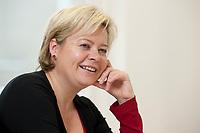 04 NOV 2010, BERLIN/GERMANY:<br /> Gesine Loetzsch, Die Linke, Parteivorsitzende, waehrend einem Interview, in Ihrem Buero, Karl-Liebknecht-Haus<br /> IMAGE: 20101104-01-019<br /> KEYWORDS: Gesine Lötzsch