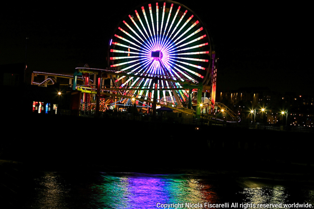 A night view of the Santa Monica Pier ferris wheel in Santa Monica California.