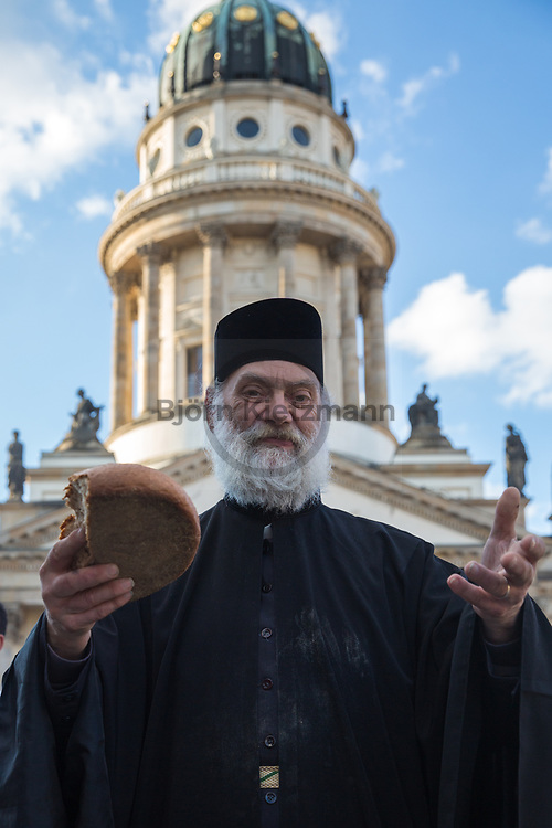 Berlin, Germany - 26.05.2017<br /> <br /> Orthodox Vespers with breadbreaks in the ecumenical community on the Gendarmenmarkt. German Protestant Church Assembly (&quot;Deutscher Evangelischer Kirchentag&rdquo;) in Berlin. <br /> <br /> Orthodoxe Vesper mit Brotbrechen in oekumenischer Gemeinschaft auf dem Gendarmenmarkt. Deutscher Evangelischer Kirchentag 2017 in Berlin. <br /> <br /> Photo: Bjoern Kietzmann