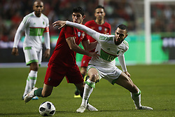 June 7, 2018 - Lisbon, Portugal - Portugal's forward Goncalo Guedes (L) vies for the ball with Algelia's forward Nabil Bentaleb (R)  during the FIFA World Cup Russia 2018 preparation match between Portugal vs Algeria in Lisbon on June 7, 2018. (Credit Image: © Carlos Palma/NurPhoto via ZUMA Press)